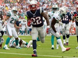 New England Patriots and Miami Dolphins NFL: Stevan Ridley Photographic Print by John Bazemore