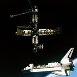 Space Shuttle Atlantis Departing the Mir Russian Space Station Photo