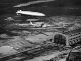Hindenburg's Arrival with an Escort Plane over Lakehurst, New Jersey Photographic Print