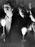 Kent State University Students Hold Candles During a Silent Vigil Posters