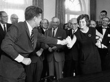 Eunice Shriver Receives a Signing Pen from Her Brother, President John Kennedy Photographic Print