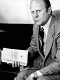 President Gerald Ford Holds Official Report of Rockefeller Commission's Investigation of the CIA Print