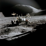 Apollo 15 Astronaut James Irwin Works at the Lunar Roving Vehicle at Hadley-Apennine Landing Site Photo