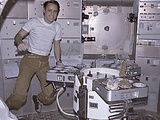 Skylab 4 Astronaut Ed Gibson Preparing His Meal Aboard the Skylab Space Station Photo