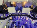 NASA Astronauts and Industry Experts Check Out the Crew Accommodations in the Dragon Spacecraft Print