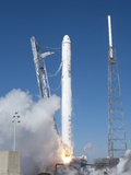 Spacex'S Falcon 9 Rocket and Dragon Spacecraft Lift Off from Cape Canaveral Air Force Station Photo