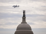 Retiring Space Shuttle Discovery Atop a NASA 747, Flies by the US Capitol Photo