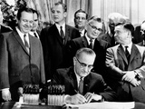 President Lyndon Johnson Signs a $11.5 Billion Tax Cut Bill Photo
