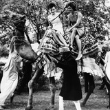 Jacqueline Kennedy and Her Sister, Princess Lee Radziwill Riding a Camel Photo