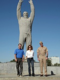 Us Astronauts and Russian Cosmonauts Pose in Front of a Monumental Statue of Yuri Gagarin Poster