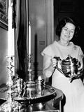 Lady Bird Johnson Holds a Silver Teapot Made by Issac Hutton Photographic Print