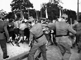 West Berlin Police Attempt to Control Demonstrating East German Youths Photo