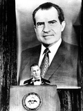 A Huge Portrait of President Nixon Dominates the Scene Photo