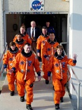 Commander Eileen Collins with Space Shuttle Mission 114 Crew En Route to the Launch Pad, Jul 2005 Posters