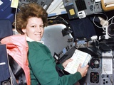 Commander Eileen Collins Consults Checklist in Shuttle Columbia, Jul 24, 1999 Poster