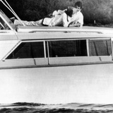 Lynda Bird Johnson Relaxes on Her Father's Cabin Cruiser with Weekend Guest, Actor George Hamilton Photo