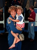 Commander Eileen Collins and Daughter, Bridget Youngs, after Space Shuttle Mission 95, Jul 28, 1999 Prints