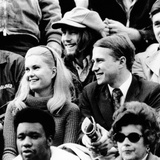 Edward and Tricia Nixon Cox Enjoy the Football Game at Harvard Stadium Photo