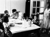 African American Mother Serves Six Children Breakfast of Corn Flakes and Milk, NY's Harlem District - Photo