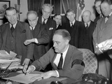Pres Franklin Roosevelt Signs Joint Congressional Resolution Declaring War, 4:10pm, Dec 8, 1941 Photo
