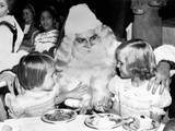 Julie, 4, and Patricia, 6, Daughters of Vice President-Elect Richard Nixon, with Santa Claus Photo