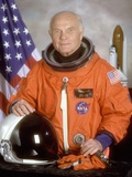 Astronaut John Glenn Returned to Space 36 Years after His Historic 1962 Flight Poster