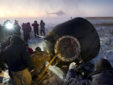 Soyuz TMA-02M Spacecraft Is Opened by Russian Land Crew in Kazakhstan Poster
