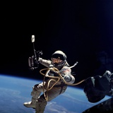 Astronaut Edward White Floating Weightless During the First US Spacewalk, June 3, 1965 Photo