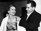 Vice President Richard Nixon Helping His Wife Pat on with a White Fur Evening Jacket, May 20, 1955 Photo