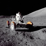 Apollo 17 Astronaut Eugene a Cernan Driving the Lunar Rover Photo