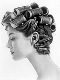 1960s Bouffant Hair Styles Created with Big Rollers and Pin Curls to Create a Soft Flip Up at Neck Photo