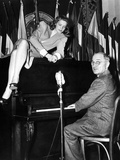 Actress Lauren Bacall Sits Atop the Piano While Vice President Harry Truman Plays Photo