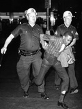 An African American Who Police Accused of Wielding a Knife Is Taken into Police Custody Photographic Print