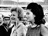 First Lady Pat Nixon and Imelda Marcos Stand under an Umbrella at Manila Airport Photo