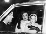 President John and Jacqueline Kennedy in a Limousine with their Four Year Old Daughter Caroline Prints