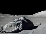 Apollo 17 Geologist-Astronaut Harrison Schmitt Standing Next to a Huge, Split Lunar Boulder - Photo