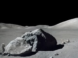 Apollo 17 Geologist-Astronaut Harrison Schmitt Standing Next to a Huge, Split Lunar Boulder Photo