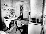 Young African American Studies by Kitchen Stove Because His Apartment Is Without Heat Photographie