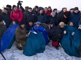 After 5 Mos in Space, Crew of Soyuz TMA-02M Capsule Recline in Chairs after Landing in Kazakhstan Photo