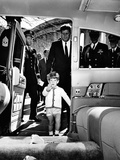 John Kennedy Jr Enters the Presidential Limousine as His Father, the President, Follows Posters