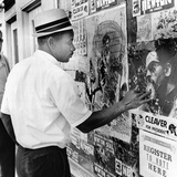 An African American Pokes His Finger into a Bullet Hole in the Oakland Black Panther's Headquarters Photographic Print