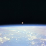 Moon Set and Earth Horizon Taken from Space Shuttle Discovery, July 14, 1995 Photo