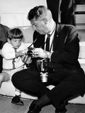 John F Kennedy Jr Looks at Cameras of White House Photographer Capt Cecil Stoughton, Nov 11, 1963 Photo
