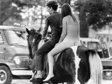 A Naked Young Women and Escort Ride a Horse Through Goose Lake Park at 3 Day Rock Music Festival Posters