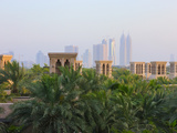 Traditional Wind Houses with Modern High-Rises in the Distance, Dubai, United Arab Emirates Photographic Print by Keren Su