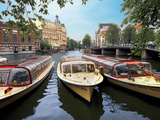 Refurbished Old Canal Cruise Boats Moored Along Amstel Canal in Amsterdam, the Netherlands Photographic Print by Miva Stock