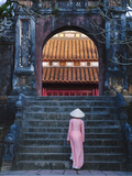 Girl in Ao Dai (Traditional Vietnamese Long Dress) and Conical Hat at Minh Mang Tomb, Vietnam Photographic Print by Keren Su