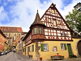Cross Timbered Houses and Clock Tower, Rothenburg Ob Der Tauber, Germany Photographic Print by Miva Stock