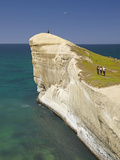 Tourists on Cliff Top at Tunnel Beach, Dunedin, South Island, New Zealand Photographic Print by David Wall