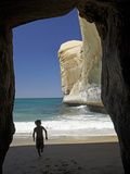 Boy Playing in Sea Cave, Tunnel Beach, Dunedin, South Island, New Zealand Photographic Print by David Wall